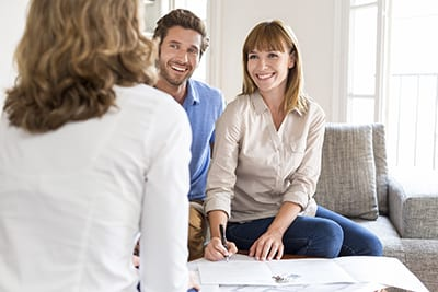 Young couple owners meeting real estate agent for hous